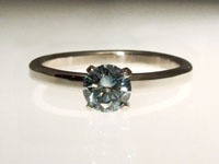 blue cultured diamond alternative engagement ring