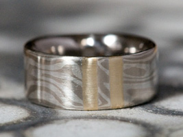 mokume gane wedding ring with solid gold inlay