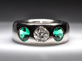 white gold and emerald engagement ring