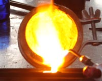 melting gold and pouring an ingot