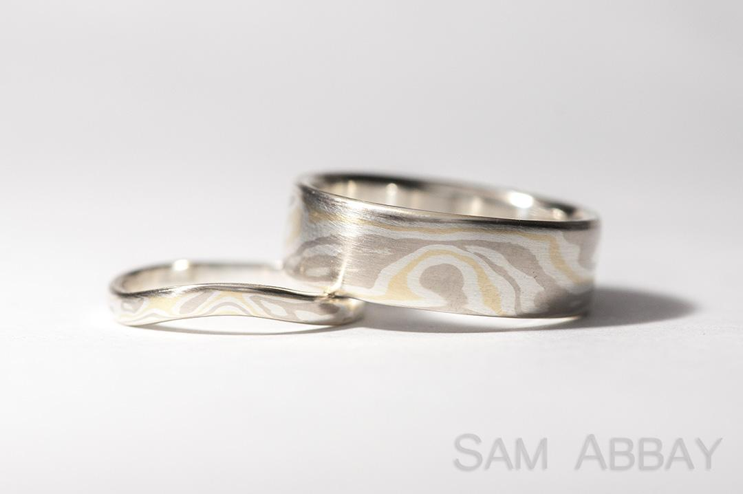 silver yellow white gold mokume wedding rings it is a little counter intuitive but adding yellow gold to the mix actually makes the pattern more subtle - Gold And Silver Wedding Rings