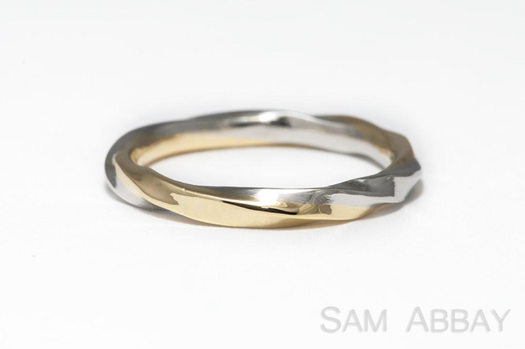 gold and platinum are fused together and twisted to create this mixed metal wedding ring we can make twisted bands with any combination of yellow gold - Platinum Wedding Rings