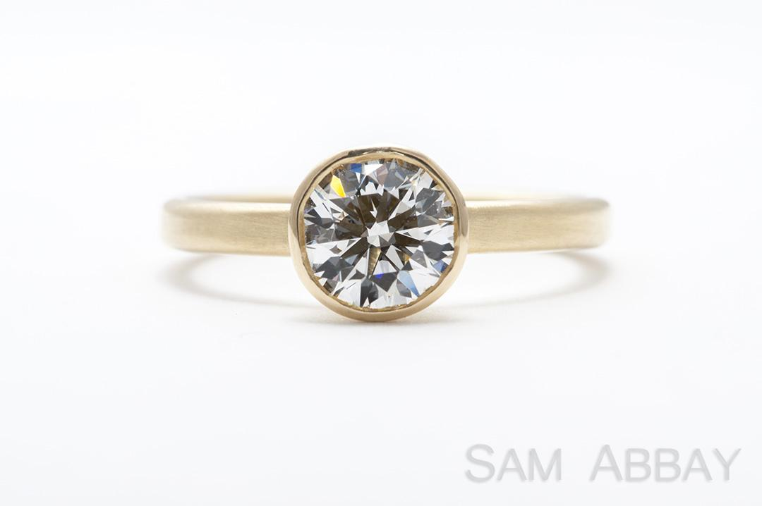 18k bezel solitaire engagement ring gold wraps around the entire diamond to create a distinctive setting with a more contemporary look - Wedding Rings Nyc