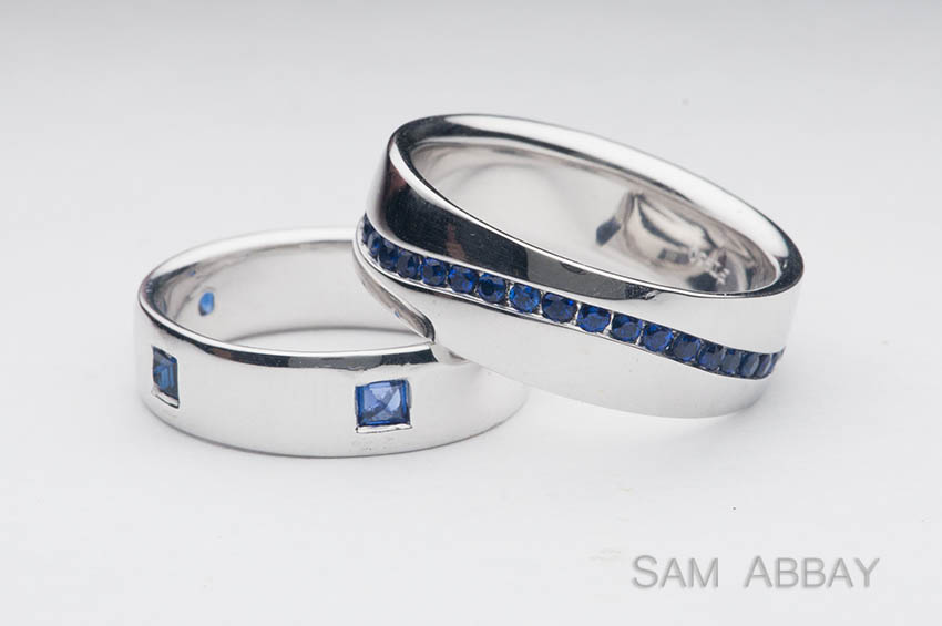 mens wedding rings with sapphires one platinum ring sports upside down sapphires from his mothers family the other has a squiggly channel of sapphires - Wedding Rings Platinum